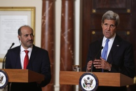 Secretary of State John Kerry and Ahmad al-Jarba, president of Syria's main opposition bloc, speak to reporters at the State Department in Washington, Thursday, May 8, 2014. In addition to speaking about Syria, Kerry commented on the situation of kidnapped school girls in Nigeria. (AP Photo/Charles Dharapak)