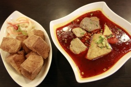 A plate of fried stinky tofu (L) and a mala (Chinese hot peppercorn) soup variety of stinky tofu are displayed at the Jiaziyuan Restaurant in New Taipei city July 25, 2013. The smellier, the better. That's the rule in Taiwan for stinky tofu, a popular fermented snack that assaults the nose but pleases the palate. Picture taken July 25, 2013.