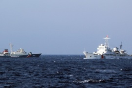 A picture made available 16 May 2014 shows a Chinese coast guard vessel (R) and a Vietnamese coast guard vessel (L) near the area of China's oil drilling rig in disputed waters in the South China Sea, off shore Vietnam, 14 May 2014. Vietnam accused Chinese boats of repeatedly ramming Vietnamese vessels near disputed waters in the South China Sea where China has placed an oil drilling platform near the Paracel Islands.
