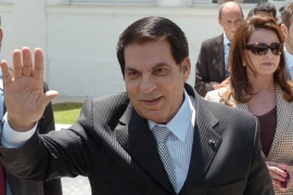 Tunisian President Zine El Abidine Ben Ali (front) waves to wellwishers after voting for the municipal elections next to his wife Leila (C) and his son-in-law the Tunisian businessman Sakhr Materi (R) on May 9, 2010 in Tunis. Polls opened in Tunisia on May 9, 2010, for municipal elections in which the ruling party of long-time President Zine El Abidine Ben Ali is widely tipped to come out victorious.