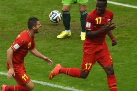 Belgium's forward Divock Origi (R) celebrastes his goal against Russia with forward Kevin Mirallas during a Group H football match between at the Maracana Stadium in Rio de Janeiro during the 2014 FIFA World Cup on June 22, 2014. AFP PHOTO / YASUYOSHI CHIBA