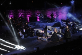 "Franch singers Claire Péro (R) and Maeva Méline (L) perform in the ""Mozart, l'opéra rock"" during the closing of the 50th session of the International Carthage Festival on August 16, 2014 at the Roman theater of Carthage near Tunis.    AFP PHOTO / FETHI BELAID"