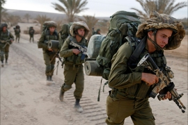 Israeli soldiers walk outside the Gaza Strip as they proceed towards Gaza August 2, 2014. Hamas claimed responsibility on Saturday for a deadly Gaza Strip ambush in which an Israeli army officer may have been captured, but said the incident likely preceded and therefore had not violated a U.S.- and U.N.-sponsored truce. Palestinian officials say 1,653 Gazans, mostly civilians, have been killed. Sixty-three Israeli soldiers have been killed, and Palestinian shelling has killed three civilians in Israel. Israel launched a Gaza air and naval offensive on July 8 following a surge of cross-border rocket salvoes by Hamas and other Palestinian guerrillas, later escalating into ground incursions centred along the tunnel-riddled eastern frontier of the enclave but often pushing into residential areas. REUTERS/Baz Ratner (ISRAEL – Tags: CIVIL UNREST MILITARY POLITICS CONFLICT)