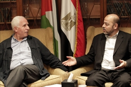epa04415419 Member of Palestinian Fatah party, Azzam al-Ahmad (L), meets with Hamas politburo member Musa Abu Marzouk (R)  at a hotel in Cairo, Egypt, 24 September 2014. Media reports state indirect Israeli-Palestinian negotiations on a long-term Gaza truce started in Cairo on 23 September, days before expiry of a one-month truce that temporarily ended 50 days of deadly cross-border fighting. Fatah and Hamas are also holding separate Egyptian-mediated talks in Cairo in a bid to reach a unified stance on Gaza between the two Palestinian rivals  EPA/KHALED ELFIQI