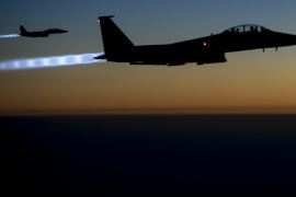 In this Tuesday, Sept. 23, 2014, photo, released by the U.S. Air Force, a pair of U.S. F-15E Strike Eagle flies over northern Iraq, after conducting airstrikes in Syria. U.S.-led coalition warplanes bombed oil installations and other facilities in territory controlled by Islamic State militants in eastern Syria on Friday, Sept. 26, 2014, taking aim for a second consecutive day at a key source of financing that has swelled the extremist group's coffers, activists said. (AP Photo/U.S. Air Force, Matthew Bruch)