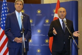 Turkey's Minister of Foreign Affairs Mevlut Cavusoglu, right, and U.S. Secretary of State John Kerry speak to the media before a meeting in Ankara, Turkey, Friday, Sept. 12, 2014. Kerry is in the region to speak with leaders about strategies to address the threat from ISIS. Secretary of State John Kerry said on Friday that the US would provide an additional $500 million in humanitarian aid to victims of the war in Syria, bringing total American assistance to $2.9 billion since the start of the conflict in 2011.(AP Photo/Burhan Ozbilici)