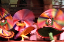 Egyptian dancers spinning a tanoura skirt during Ramadan Festival at Al Ghoury Palace in Cairo, Egypt, early on 10 July 2014. Al Tanoura is usually practiced by Sufi Muslims and is a spiritual practice where spinning and discarding three skirts represents the circular movement of the world.