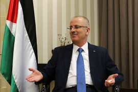 "Palestinian Prime Minister Rami Hamdallah gestures during an interview with AFP at his office in the West Bank city of Ramallah on September 7, 2014. Prime Minister Hamdallah told AFP that his government has been threatened with a ""boycott"""
