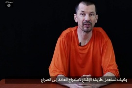 An undated handout video grab provided by the Islamic State via IntelCenter on 23 September 2014 shows British hostage John Cantlie held by Islamic State militants at an undisclosed location. A second video purportedly of British hostage John Cantlie was released by the Islamic State as the United States and Arab allies hit the extremist group's targets inside Syria for the first time. Journalist John Cantlie has been held hostage for almost two years. In the video, entitled Lend Me Your Ears: Message from the British Detainee John Cantlie: Episode 1, he is critical of the military campaign against the militant group. EPA/ISLAMIC STATE VIDEO/HANDOUT