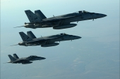 epa04416226 A handout picture made available by the US Department of Defense (DoD) on 25 September 2014 shows a formation of US Navy F-18E Super Hornets leaving after receiving fuel from a KC-135 Stratotanker over northern Iraq, 23 September 2014. These aircraft were part of a large coalition strike package that was the first to strike Islamic State (IS or ISIL) targets in Syria. Airstrikes carried out on late 24 September 2014 against Islamic State targets in Syria hit oil refineries that the US says provide a revenue stream for the militants, the Pentagon says. The oil refineries provide about 2 million US dollar a day in revenue for the Islamic State, Rear Admiral John Kirby says. Kirby spoke after the raids ended and all aircraft returned safely. The United States was joined by Saudi Arabia and the United Arab Emirites in carrying out the strikes, Kirby says.  EPA/DOD/US AIR FORCE/SGT. SHAWN NICKEL  HANDOUT EDITORIAL USE ONLY