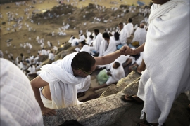 Muslim pilgrims gather on Mount Arafat near Mecca as they perform one of the Hajj rituals late on October 3, 2014. The pilgrims perform a series of rituals during the annual Hajj. They circumambulate the kaaba seven times, runs back and forth between the hills of Al-Safa and Al-Marwah, drink from the Zamzam Well, goes to the plains of Mount Arafat to stand in vigil, and throws stones in a ritual Stoning of Devil