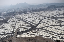 An aerial view shows tens of thousands of tents hosting piligrms in Mina near the holy city of Mecca, on October 5, 2014. Pilgrims pelt pillars symbolizing the devil with pebbles to show their defiance on the third day of the hajj as Muslims worldwide mark the Eid al-Adha or the Feast of the Sacrifice, marking the end of the hajj pilgrimage to Mecca and commemorating Abraham's willingness to sacrifice his son Ismail on God's command in the holy city of Mecca. AFP PHOTO/MOHAMMED AL-SHAIKH