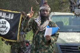 A screengrab taken on October 2, 2014 from a video released by the Nigerian Islamist extremist group Boko Haram and obtained by AFP shows the leader of the Nigerian Islamist extremist group Boko Haram, Abubakar Shekau delivering a speech. Shekau dismissed Nigerian military claims of his death in a new video obtained by AFP on October 2 and said the militants had implemented strict Islamic law in captured towns.  AFP PHOTO / HO / BOKO HARAM