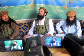 A picture made available on 15 October 2014 shows Shahidullah Shahid (C), the spokesman of Pakistani Talibans speaking to journalists at an undisclosed location near the Pak-Afghan border, 21 February 2014. Five Taliban commanders in Pakistan and their spokesman announced formal allegiance on 15 October to the Islamic State militant group, in a blow to al-Qaeda's dominance in the region. Spokesman Shahidullah Shahid said he had accepted the leadership of the Islamic State chief, Abu Bakr al-Baghdadi, whose group has taken over large swatches of territory in Iraq and Syria.