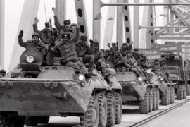 FILE – In this Feb. 15, 1989 file photo, Soviet Army soldiers wave their hands as their last detachment crosses a bridge on the border between Afghanistan and then Soviet Uzbekistan near the Uzbek town of Termez, as they leave Afghanistan after waging a 10-year war. The Soviet Union lost some 15,000 soldiers in the war, which began in 1979 when Moscow sent in troops to battle guerrillas who were fighting a Soviet-supported government. For 10 years, ever since the towers fell, the United States has fought a war in a distant land _ in hopes, it says, of protecting American interests and making the world safer from terrorism. Now, as President Barack Obama plans to end U.S. combat operations in Afghanistan by 2014, the question remains as muddy as ever: What happened here?.