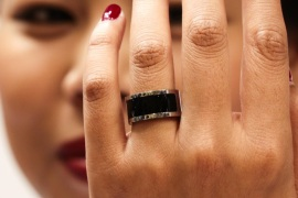 A woman shows a prototype of the Mota Smart Ring at the consumer electronic fair IFA in Berlin, Germany, Friday, Sept. 5, 2014. The smart ring is designed to notify users about incoming messages and phone calls.  (AP Photo/Markus Schreiber)