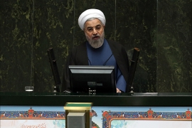 Iranian President Hassan Rouhani delivers a speech to parliament before presenting the proposed annual budget in Tehran on December 7, 2014. Iran's parliament has adopted a law on December 4, to tax religious foundations and military-linked companies, a first for the Islamic republic that could generate hundreds of millions of dollars in revenues, media reported. AFP PHOTO/ATTA KENARE
