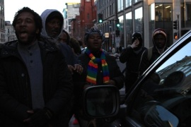 WASHINGTON, DC – DECEMBER 07: Dozens of protesters march throughout downtown and stop the the traffic at major intersections in Washington, United States on December 7, 2014 to protest the killings of unarmed black men by police officers.