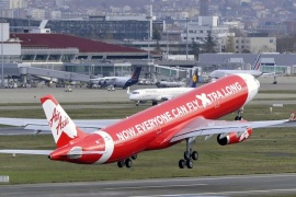 An Airbus A330 aircraft of the Malaysian company Air Asia takes off the Toulouse -Blagnac airport on December 12, 2014 in Blagnac.  AFP PHOTO / PASCAL PAVANI