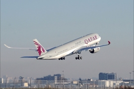 A Qatar Airways A350 takes off from the Airbus headquarters in Toulouse on December 22, 2014. Airbus delivered its first next-generation A350-900 plane to Qatar Airways in a formal ceremony that kickstarts its bid to erode rival Boeing's dominance in the lucrative long-haul market. AFP PHOTO / REMY GABALDA