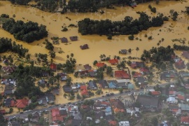 An aerial view of a settlement submerged by floodwaters in the Pengkalan Chepa district of Kelantan, Malaysia, 28 December 2014. The  Malaysian government described this flood as the worst in 30 years, at least five people were killed and more than 118,000 people have sought shelter in the hundreds of evacuation centers opened by the government. Malaysian Prime Minister Najib Razak is to cut short a holiday in the United States to deal with major floods at home after coming under fire for spending time golfing with US President Barack Obama in Hawaii during the floods.