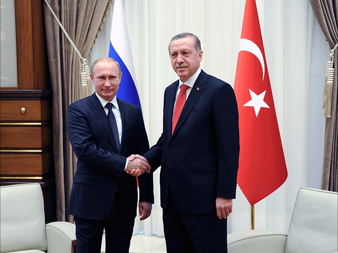 epa04510751 Russian President Vladimir Putin (L) shakes hands with his Turkish counterpart Recep Tayyip Erdogan during their meeting in the new presidential palace outside Ankara, Turkey, 01 December 2014. Putin and Erdogan began a meeting in Ankara to discuss their often opposing views on the crisis in Syria, the Islamic State threat and gas supplies to Turkey. Putin is on a one-day official visit to Turkey.  EPA/MIKHAIL KLIMENTYEV / RIA NOVOSTI / KREMLIN POOL