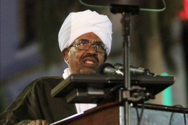 Sudanese President Omar al-Bashir gives a speech during the celebration to mark 59 years of independence from Britain, in Khartoum on December 31, 2014. Bashir said elections slated for April and widely expected to extend his rule must go ahead on schedule to preserve stability, despite opposition calls for a delay. AFP PHOTO / ASHRAF SHAZLY
