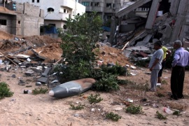 GAZA CITY, GAZA – JULY 14: Palestinians inspect unexploded air missile near a house destroyed in air attacks staged by Israel army within the scope of 'Operation Protective Edge' in Gaza City, Gaza on July 14, 2014. At least 172 people have been killed and around 1268 injured since the start of the Israeli military operation.