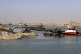 Dredgers float on a new section of the Suez canal during a media tour in Ismailia, Egypt, Wednesday, Feb. 4, 2015.  The head of the Suez Canal Authority, Mohab Mameesh, says work is on schedule and that so far, 86 percent of the dry digging and 21 percent of the dredging has been completed, with the new section expected to be completed in August 2015.  (AP Photo/Hassan Ammar)