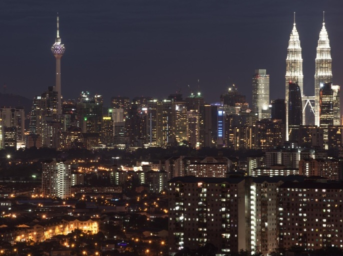 The city skyline of Kuala Lumpur in Ampang is seen on November 17, 2014. Growth in Malaysia's economy slowed to a 'moderate' 5.6 percent in the third quarter as exports decelerated, the central bank said on November 14, but it added that domestic demand was expected to support steady expansion. AFP PHOTO / MOHD RASFAN
