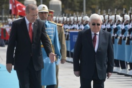 ANKARA, TURKEY – APRIL 22: President of Turkey Recep Tayyip Erdogan (front L) and Iraqi President Fuad Masum (front R) review the honor guard during an official welcoming ceremony at the presidential palace in Ankara, Turkey on April 22, 2015.