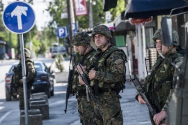 Macedonian police officers patrol in a street in the town of Kumanovo on May 10, 2015. Shooting broke out for a second day on May 10 in north Macedonia as concern mounted in Europe after clashes between police and unidentified gunmen that erupted on May 9 at dawn in the restive north of Macedonia. Eight policemen and 14 gunmen have been killed in two days of clashes, police said on Sunday.  AFP PHOTO/ARMEND NIMANI