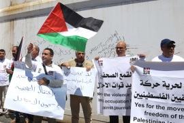 BETHLEHEM, WEST BANK – MAY 02: A group of journalists stage a demonstration to protest Israel's violence to press members ahead of the occasion of  the World Press Freedom Day in Bethlehem, West Bank on May 02, 2015. Some protesters got injured due to interference of Israeli security forces during demonstration.