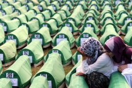 (FILE) A file picture dated 11 July 2010 shows Bosnian Muslim women mourning over a casket during the funeral of 775 newly-identified Bosnian Muslims at the Potocari Memorial Center, Srebrenica, Bosnia and Herzegovina. The burial was part of a memorial ceremony to mark the 15th anniversary of the Srebrenica Massacre. July 2015 marks the 20-year anniversary of the Srebrenica Massacre that saw more than 8,000 Bosniak men and boys killed by Bosnian Serb forces during the Bosnian war.  EPA/FEHIM DEMIR PLEASE REFER TO THIS ADVISORY NOTICE (epa04766937) FOR FULL PACKAGE TEXT *** Local Caption *** 02404574