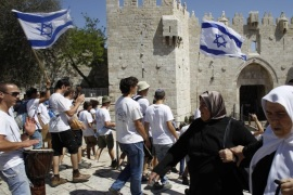 JERUSALEM – MAY 17:  A group of Jewish settlers forced their way into Al-Aqsa Mosque compound in occupied East Jerusalem as they mark 'Jerusalem Day' in Jerusalem on May 17, 2015. Israelis celebrate 17th of May as Jerusalem Day to mark their invasion of east Jerusalem anniversary occurred on the year 1967.