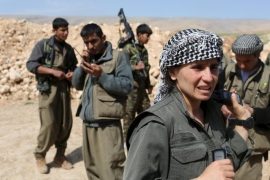 "Kurdistan Workers Party (PKK) fighters prepare to join others near a position which has been hit by Islamic State car bombs in Sinjar, March 11, 2015. Women fighters at a PKK base on Mount Sinjar in northwest Iraq, just like their male counterparts, have to be ready for action at any time. Smoke from the front line, marking their battle against Islamic State, which launched an assault on northern Iraq last summer, is visible from the base. Many of the women have cut links with their families back home; the fighters come from all corners of the Kurdish region. REUTERS/Asmaa WaguihPICTURE 27 OF 32 FOR WIDER IMAGE STORY ""KURDISH WOMEN BATTLE ISLAMIC STATE"" 