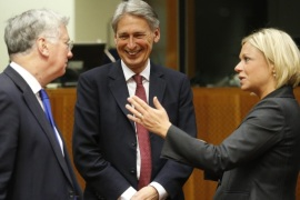 British Defence Secretary Michael Fallon, (L-R), British Foreign Secretary Philip Hammond, and Dutch Defense Minister Jeanine Hennis-Plasschaert talk prior a joint European Foreign and Defense Ministers meeting at the European Council Headquarters in Brussels, Belgium, 18 May 2015. The Middle East Peace Process is set to top the meeting's agenda.