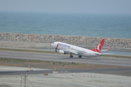 ORDU, TURKEY – MAY 22: A Turkish Airlines flight from Istanbul carrying 136 passengers touches down on its runway, in Ordu-Giresun Airport on artificial island in Ordu, Turkey on May 22, 2015. The Ordu-Giresun Airport is built on an artificial island along the seashore of Ordu, making it the first such facility outside the Far East. The airport will be the first of its kind in Turkey, as well as Europe, and eighth such facility in the world.