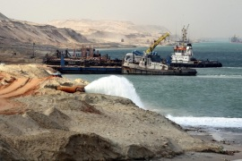 Dredgers work on a section of the New Suez Canal in Ismailia, Egypt, 13 June 2015. According to reports, Egypt has set the date for opening of the New Suez Canal for 06 August 2015.