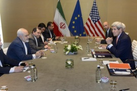 U.S. Secretary of State John Kerry, right, speaks with Iranian Foreign Minister Mohammad Javad Zarif, second  left, prior to a bilateral meeting for a new round of Nuclear Talks with Iran  at the Intercontinental Hotel, in Geneva, Switzerland, Saturday, May 30, 2015. A month out from a nuclear deal deadline, the top U.S. and Iranian diplomats gathered in Geneva Saturday in an effort to bridge differences over how quickly to ease economic sanctions on Tehran and how significantly the Iranians must open up military facilities to international inspections. (Laurent Gillieron/Keystone via AP)