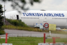 A Turkish Airlines plane is seen in Copenhagen Airport, Denmark, Thursday, June 25, 2015 . Danish police says a New York-bound Turkish Airlines plane made an emergency landing at Copenhagen's international airport after an old camera bag, possibly forgotten by a passenger, caused a bomb scare. (Kenneth Meyer/Polfoto via AP) DENMARK OUT
