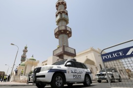 Police vehicles are parked outside the Al A'ali Grand Mosque where joint Sunni and Shi'ites prayers are to be held to show solidarity and co-existence between the two sects of Islam, ahead of Friday prayers in Al A'ali south of Manama, July 3, 2015. Following three bombings of Shi'ite mosques by the Islamic State militant group in Saudi Arabia and Kuwait since May 22, Sunnis and Shi'ites in Kuwait and in Bahrain will pray together in main mosques, as a sign of national unity and in a challenge to the militant group, which is expanding, notably in Egypt, Libya and Yemen, from its strongholds in Iraq and Syria.  REUTERS/Hamad I Mohammed