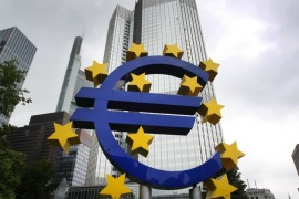 The Euro logo is pictured in front of the former headquarter of the European Central Bank (ECB) in Frankfurt am Main, western Germany, on July 20, 2015 as Greece has begun making a 4.2 billion euro ($4.6 billion) payment due to the ECB as well as outstanding sums due to the International Monetary Fund (IMF) according to a ministerial source. The transfer was made possible by a short-term 'bridge' loan of 7.16 billion euros granted by the European Union on July 17, 2015.AFP PHOTO / DANIEL ROLAND