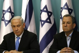 Israeli Prime Minister Benjamin Netanyahu sits next to Defence Minister Ehud Barak during a statement to the press at his Jerusalem office on November 21, 2012. Israel and Hamas agreed on a truce that will take effect this evening in a bid to end a week of bloodshed in and around Gaza that has killed more than 150 people, Egypt and the United States said.