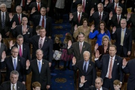 Members of the House are sworn in during a ceremony on the floor of the House of Representatives as the 114th Congress convenes on Capitol Hill January 6, 2015 in Washington, DC. Republican John Boehner was re-elected and sworn in Tuesday as speaker of the US House of Representatives, overcoming a surprisingly robust attempt to oust him by two dozen hardcore conservatives. Boehner received 216 of the 408 votes cast in the chamber, winning as expected over Democrat leader and former House speaker Nancy Pelosi, who received 164 votes.  AFP PHOTO/BRENDAN SMIALOWSKI