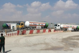 KEREM SHALOM, ISRAEL – AUGUST 28:  Fuel tanks brought by articulated lorries for Palestinians, in Kerem Shalom Border Gate, Israel on 28 August, 2014.