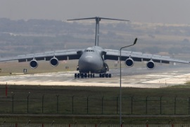A United States Air Force cargo plane maneuvers on the runway after it landed at the Incirlik Air Base, in the outskirts of the city of Adana, southeastern Turkey, Wednesday, July 29, 2015. After months of reluctance, Turkish warplanes started striking militant targets in Syria last week, and also allowed the U.S. to launch its own strikes from Turkey's strategically located Incirlik Air Base. (AP Photo/Emrah Gurel)