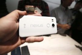 "The new Google Nexus 5X models is on display during a Google event on Tuesday, Sept. 29, 2015, in San Francisco. Google is countering the release of Apple's latest iPhones with two devices running on ""Marshmallow,"" a new version of Android software designed to steer and document even more of its users' lives. (AP Photo/Tony Avelar)"