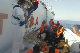 A handout photoreleased by the Italian Coast Guard (Guardia Costiere) on 20 September 2015 is a still grab from a video taken during an operation in the Mediterranean Sea as the Coast Guard in which they rescue 130 migrants at sea on 19 September 2015. Media reports say that around 4,700 migrants were rescued in different operation on Mediterranean Sea on Saturday, 19 September 2015. (ATTENTION EDITORS: Editorial use only in connection with reporting on the events depicted in the image)  EPA/GUARDIA COSTIERA/HANDOUT