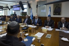 Israeli Prime Minister Benjamin Netanyahu (C) attends the weekly cabinet meeting in his Jerusalem 20 September 2015. Netanyahu was considering increasing penalties on stone throwers following clashes over the past days between stone-throwing Palestinian youths and Israeli security forces following afternoon Islamic prayers, amid rising tension over a contested holy site in Jerusalem. The violence came as Israel placed restrictions on Muslim males wishing to pray at the al-Aqsa mosque, only letting in men over the age of 40. Palestinians have voiced concern about recent changes at holy sites in the city, as right-wing Israeli political leaders have pressed for more access to the Temple Mount area, where the al-Aqsa mosque is also located.